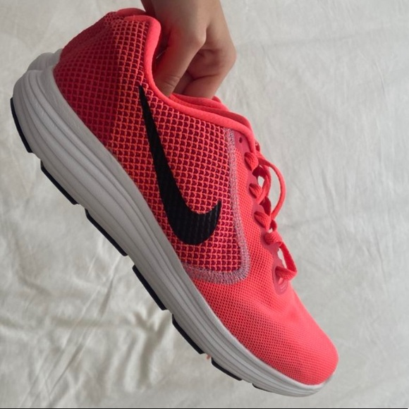 Neon pink Nike running shoes